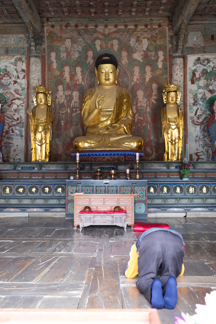 A worshipper at the Buddhist temple just outside of Busan.