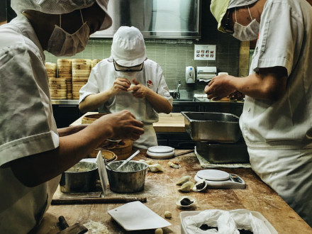 Meticulously making dumplings at Din Tai Fung